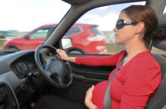 pregnant woman drive a car during pregnancy. Concept photo of pregnancy, pregnant woman lifestyle and health care.copyspace