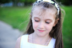 Outdoors closeup portrait of brunette little girl